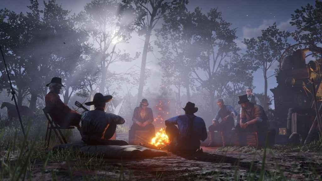 The Van Der Linde Gang sit around the fire - Red Dead Redemption 2