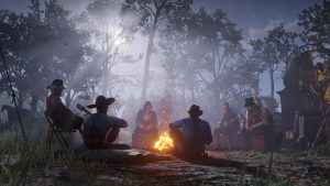 The Van Der Linde Gang sit around the fire - Red Dead Redemption 2