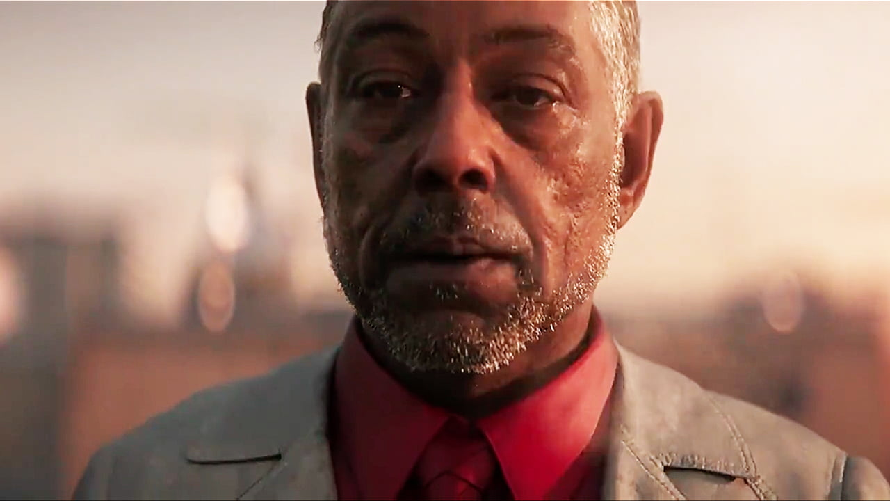 Giancarlo Esposito as Anton stands looks ominously into the distance after blowing a cigarette.
